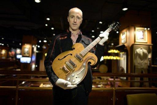 gitara bitlov byla prodana v nyu iorke za 408 000 dollarov Гитара битлов была продана в Нью Йорке за 408 000 долларов
